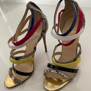 Christian Louboutin red bottoms, strappy heels